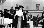 Fall Convocation : female student looking at her diploma